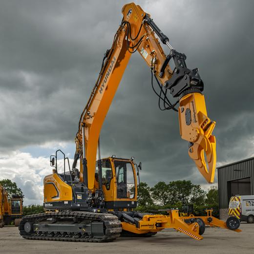 Hyundai excavator with powerhand attachment